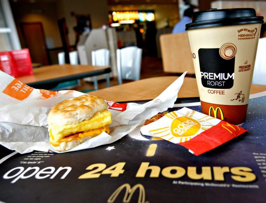 A sausage Egg McMuffin meal with hash browns and Premium Roa