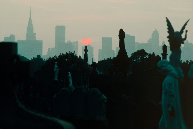 USA. New York City. 1983. The Midtown Manhattan skyline seen from a Queens cemetery.