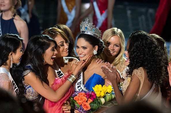 Miss Philippines Pia Alonzo Wurtzbach, Miss Universe 2015 is congratulated by pageant friends on stage during The 2015 MISS UNIVERSE Show at Planet Hollywood Resort & Casino, in Las Vegas, California, on December 20, 2015. Miss Philippines was named Miss Universe, but in a drama-filled turn worthy of a telenovela. The pageant's host comedian Steve Harvey, also a talk show host, misread the card which he said had Miss Colombia Ariadna Gutierrez as the winner. AFP PHOTO / VALERIE MACON / AFP / VALERIE MACON (Photo credit should read VALERIE MACON/AFP/Getty Images)