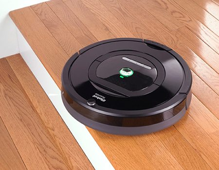 264377-irobot-roomba-770-vacuum-cleaning-robot-on-wood