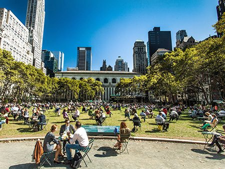 people eating lunch in bryant park