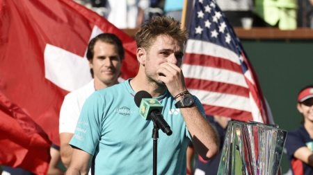 INDIAN WELLS, CA - MARCH 19: Stanislas Wawrinka of Switzerland cries during a trophy presentation after losing to Roger Federer of Switzerland in the mens final during day fourteen of the BNP Paribas Open at Indian Wells Tennis Garden on March 19, 2017 in Indian Wells, California. Kevork Djansezian/Getty Images/AFP